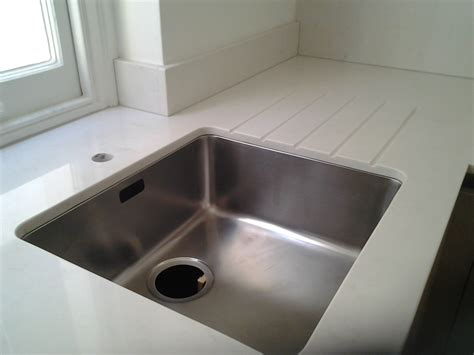 quartz undermount kitchen sinks compac carrara quartz worktops with an undermount sink