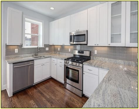 White Cabinet Grey Countertop by White Kitchen Cabinets With Gray Granite Countertops