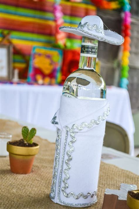 Fiesta decor. Charro dressed tequila bottles   Parties
