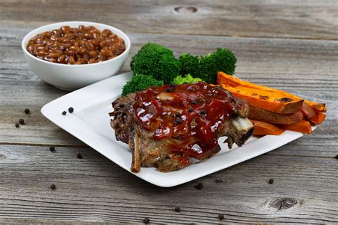 bbq ribs with side dishes photograph
