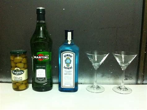 sapphire martini up with olives knifing forking spooning a gin martini