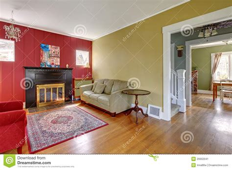red and yellow living room living room with red and yellow walls and fireplace stock