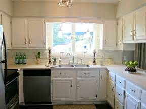 kitchen white cabinets beige countertop grey green paint