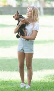 olivia holt walks her dog at a park in los amgeles   hawtcelebs