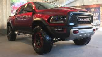 jurassic trucks ram rebel t rex vs ford f 150 raptor