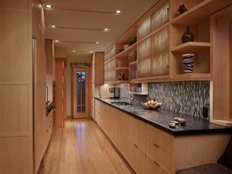 contemporary galley kitchen features cedar cabinets hgtv