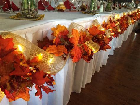 Fall wedding decor head table leaves burlap lights easy