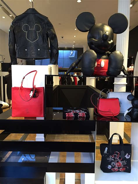 minnie mouse coach outlet disney and coach partner for new collection featuring