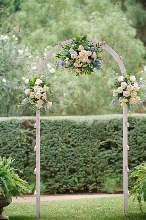 wedding garden arch blue delphinium and white garden wedding arch