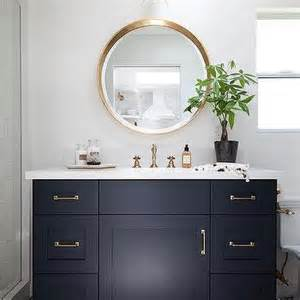 navy bathroom vanity with white quartz countertop