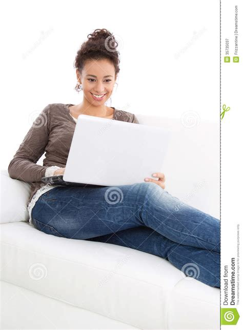 laying couch woman laying with laptop royalty free stock photography