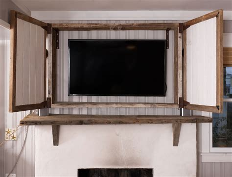 built in tv cabinet above fireplace renovated house with rustic coastal interiors home