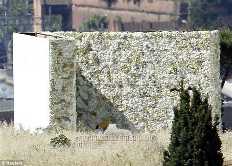 flower wall kim kardashian wedding kanye west reveals kim kardashian s wedding dress