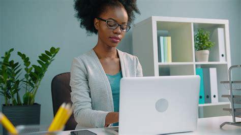 black african american business women black african american business woman in glasses working