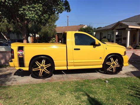 yellow black dodge ram    diablo wheels big