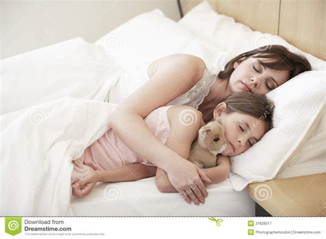 in bed with mom mother and daughter sleeping in bed stock image image of