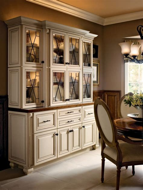 hutch cabinets dining room mullion textured glass and rubbed bronze hardware accent this maple hutch in canvas with