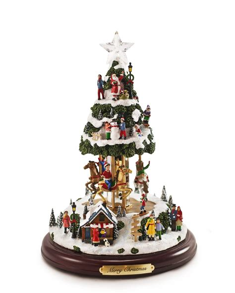 animatronic christmas decorations our animated musical tree is a miniature tree and carousel that plays