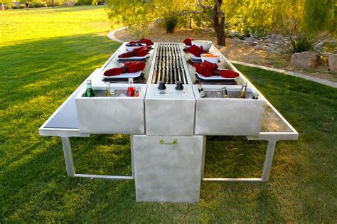 an outdoor grill you can cook and eat at picnic tables
