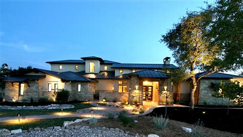 design custom home hill country modern front elevation by zbranek holt
