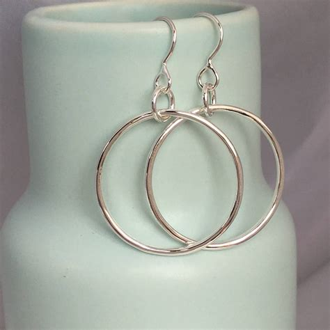 Handcrafted Silver Earrings - handmade silver drop hoop earrings by handmade by helle