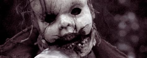 haunted doll gif scary doll