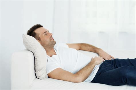 lazy person on couch couch potatoes may be genetically predisposed to being