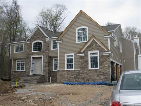 ledgestone with hardie board siding khaki beige house