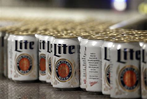 who owns coors light millercoors profit down but light beers gain market share