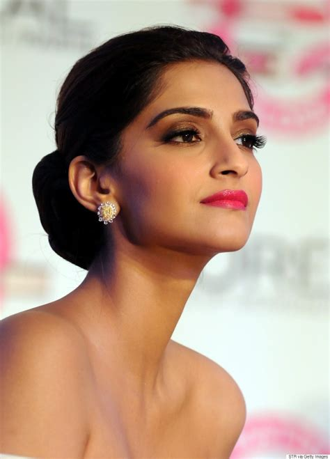 sonam kapoor stuns in white dress at l oreal paris event