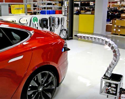 tesla model s charging tesla unveils futuristic robotic snake charger for