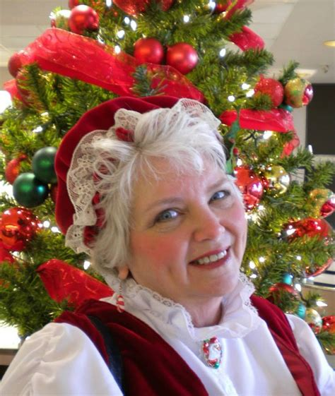 mrs claus with face painting or cookie decorating with mrs