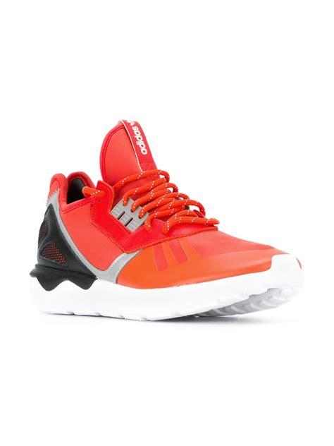 orange sneakers mens lyst adidas originals tubular runner sneakers in