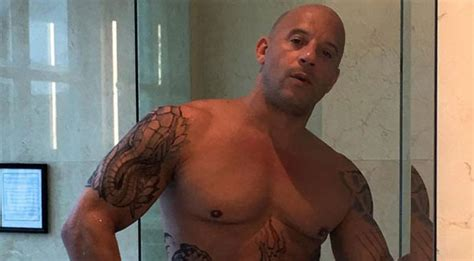 vin diesel s tattoos vin diesel goes shirtless in a towel with xander cage