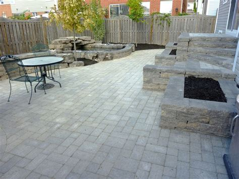 backyard patio   and stone wall backyard water feature