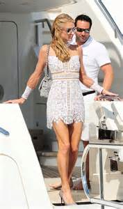 Dress Yachtien in mini dress leaving a yacht in cannes