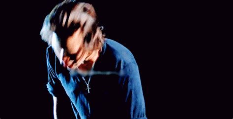 harry styles running his fingers through his hair why harry styles hair is perfect the way it is