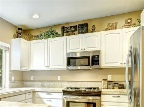 decor for above kitchen cabinets ideas for decorating above kitchen cabinets slideshow
