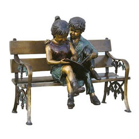 little girl sitting on bench statue bronze boy and girl reading on bench sculpture sculpture