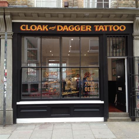 front street tattoo cloak and dagger parlour shop front on 34 cheshire