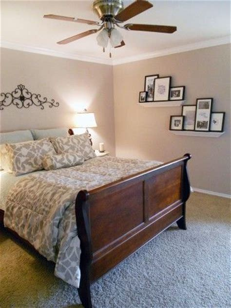 serene bedroom with staggered floating shelves for and