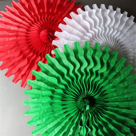paper tissue fan christmas decorations by pearl and earl