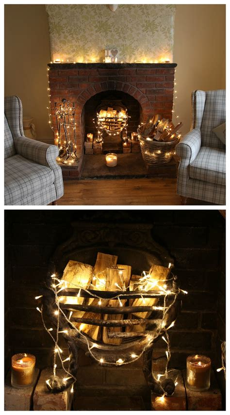 fake fireplace logs with lights fairylights around a real stone fireplace this looks