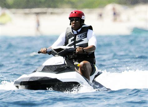 jay z riding a jet ski with a helmet is a meme now reactions - Jayz Waterscooter