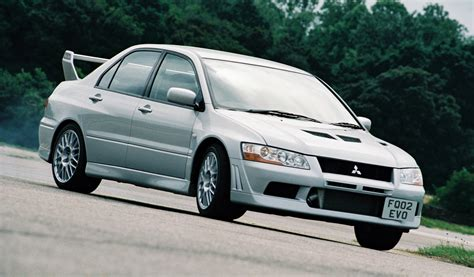 mitsubishi evolution 7 mitsubishi lancer evolution vii review history prices