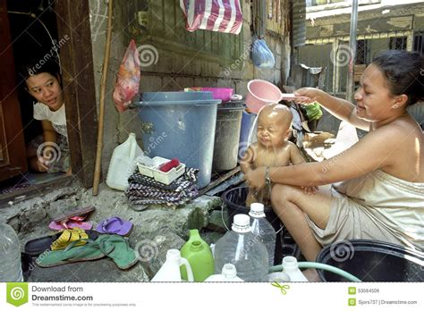 Mother Daughter House Plans mother washing child in slum malate philippines editorial