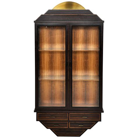 rosewood and brass wall hanging curio cabinet at
