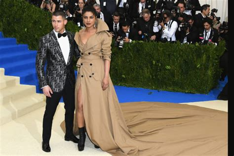 Nick Jonas Priyanka Chopra Priyanka Chopra S Wearing Just A Trench Coat Go Fug