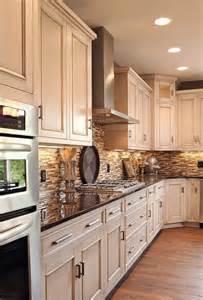 light cabinets dark counter oak floors neutral tile