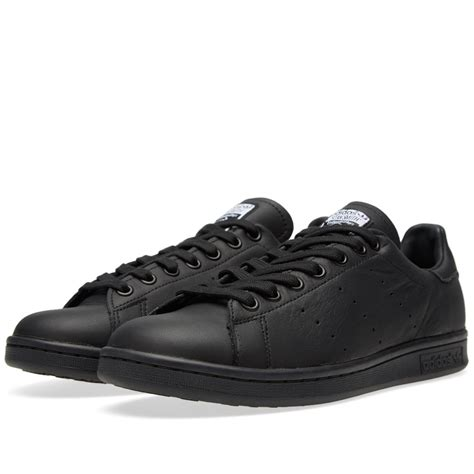 all black sneaker it s all about all black sneakers this winter